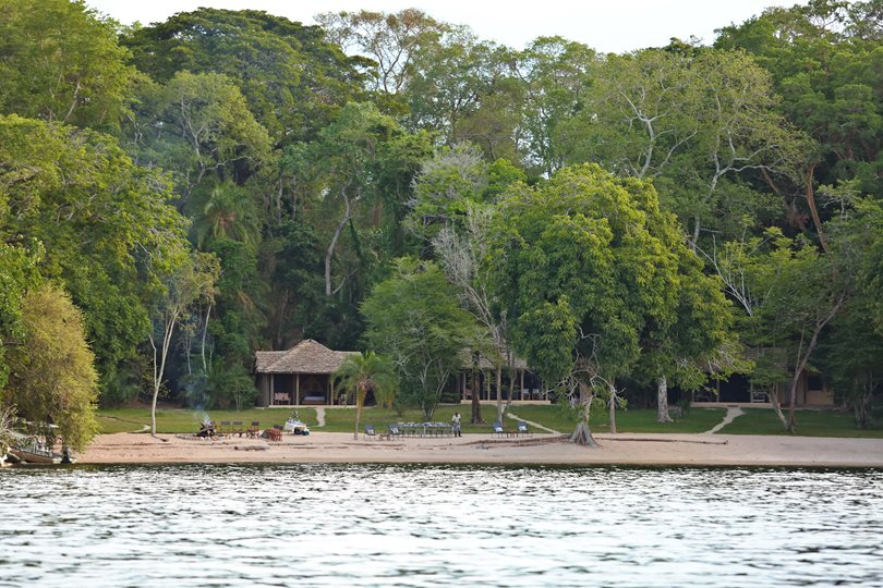 Private beach of Rubondo island where safari travelers can rest up before and after experiencing the Chimpanzee Habituation expedition.