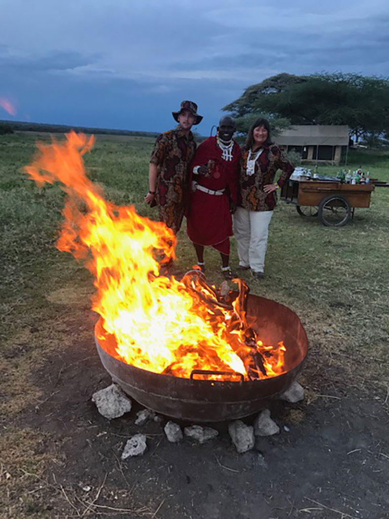 Penwell Safari Tour Guides by camp side Fire in Kenya