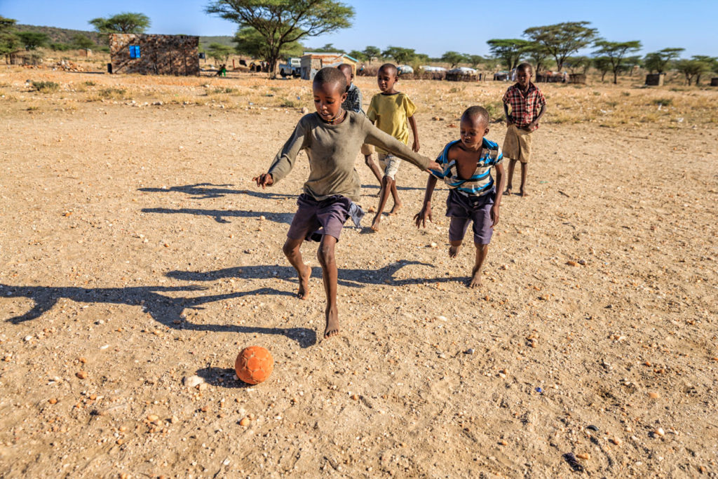 Kids in East Africa playing soccer