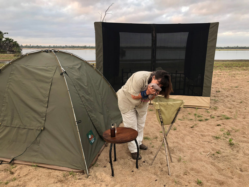 Penwell CEO Kathy Harvey washes her face before going out on Tanzania safari