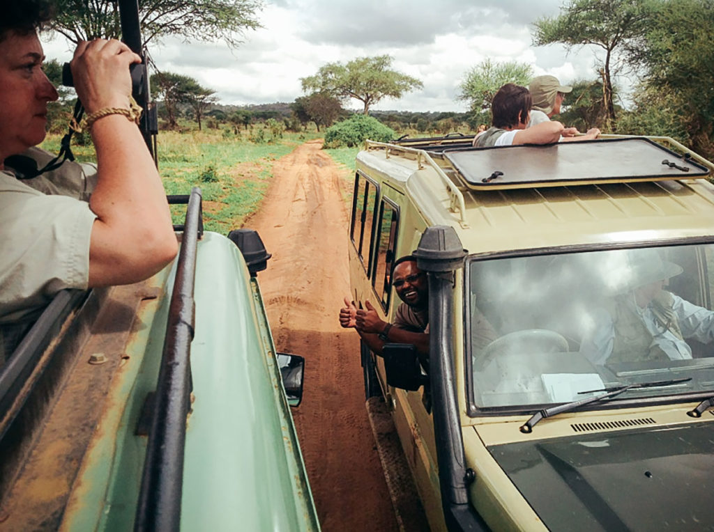 A group of safari explorers out on a game drive in Tanzania