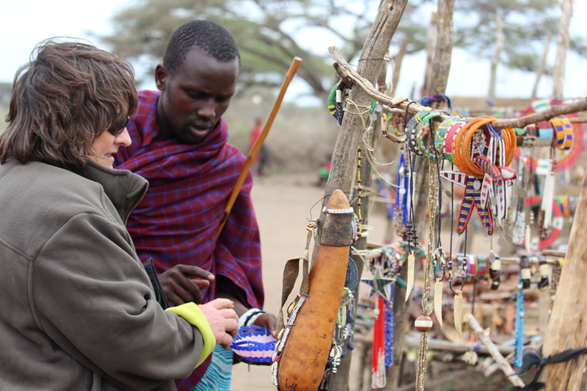 Penwell's Kathy Harvey gets shopping advice from local Maasai safari guide while in Tanzania, Africa
