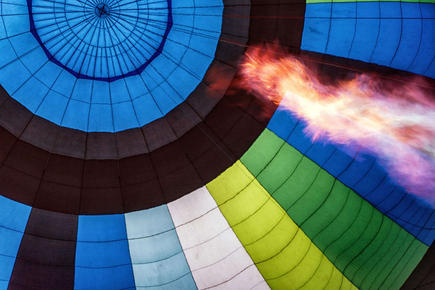 Hot air balloon with huge flame in foreground