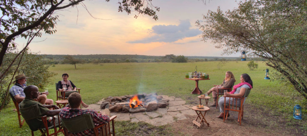Group around the campfire at the Masai Mara Naboisho Conservancy