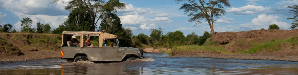 Game Drive jeep going across a river