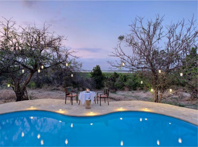 Dining by the pool at Roho ya Selous camp